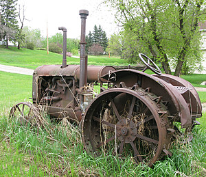 Antique farm tractor outdoors in rural Saskatchewan